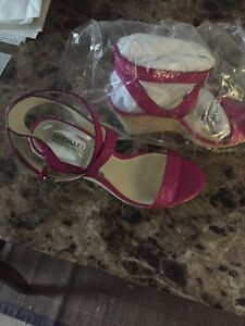 Pink Michael Kors sandals with wedge