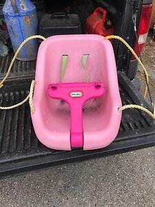 Pink kids swing