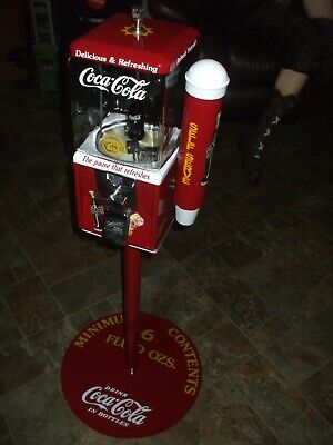 Northwestern Coca-Cola theme gumball candy machine w/glass globe stand & more