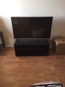 43 Inch Led LCD - Still in plastics wrap. Comes with TV Stand