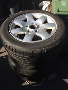 Set of 4 BMW aluminum rims with rubber