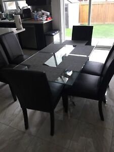 Modern glass table and 6 chairs