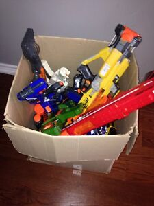 12 Nerf Guns with Assorted Accessories