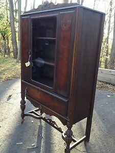 "Beautiful 1920s-1930s ""high boy"" vintage china cabinet with three shelves."