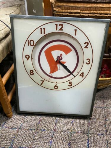 "Vintage Rare     Advertising ""F""  Electric Wall Clock lights up and works."