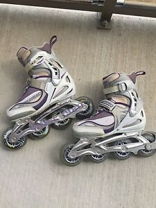Women's Size 6 rollerblades *brand new wheels and brakes*