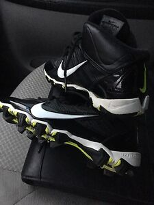Boys size 5 brand new almost alpha shark cleat