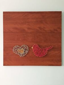 Nail and string wall art