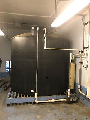 2500 gallon polypropeline water tank with stand and water transfer pump $1,500.