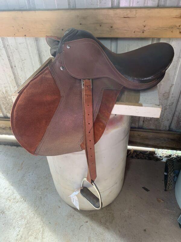 english horse saddle with stirrups
