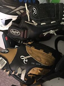 2 Rawlings ball gloves