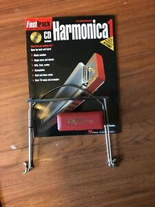 Horner golden melody harmonica C, lesson book and holder