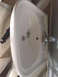 Pedestal sink and faucet.