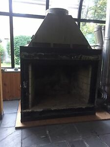 Fireplace insert with electric fan