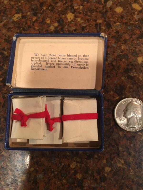 Vintage prescription box with tiny envelope packets for medicine.unique