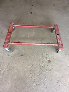 Metal frame with caster wheels