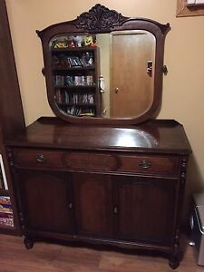 Antique ornate mirror and sideboard