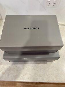 Louis Vuitton and Balenciaga boxes and bags