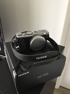 Fujifilm X70 with extra battery, charger, and 64GB SD card