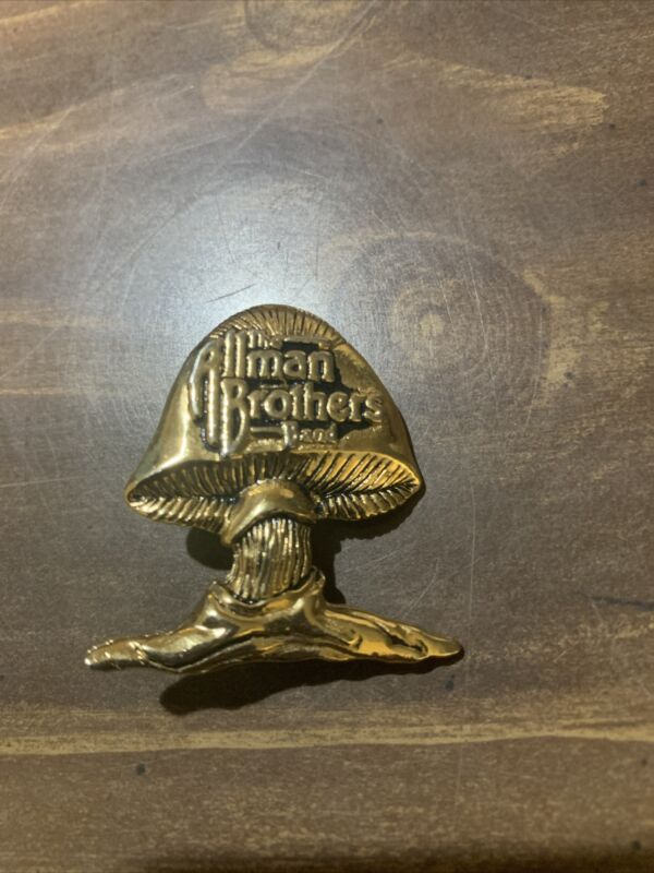 The ALLMAN BROTHERS RARE MUSHROOM LOGO 3D MOLDED PIN COLOR GOLD NEVER USED