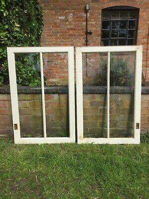 A pair of vintage glazed cupboard doors.
