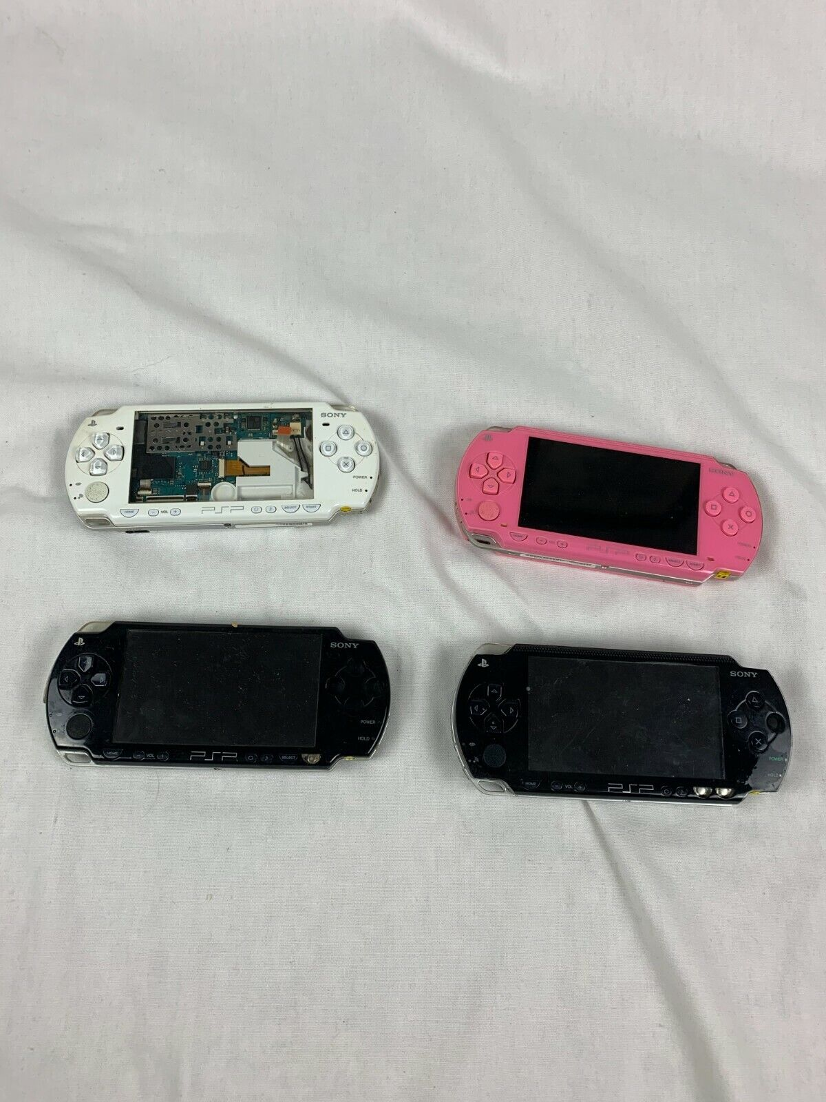 LOT OF 4 PLAYSTATION PORATBLE PSP UNITS MODELS 1000, 1001 2001 FOR PARTS AS IS - $50.00