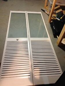 Bifold closet door with glass insert