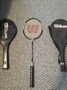 Badminton rackets with 2 holders