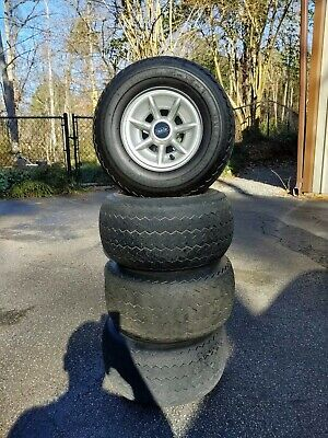 Used Set Of Golf Cart Wheels, Tires, and Hub Caps