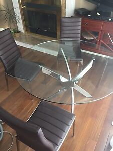 Modern kitchen table set including four chairs