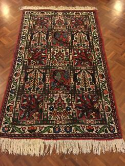 Medium to small sized Persian tribal rug with 15 picture squares