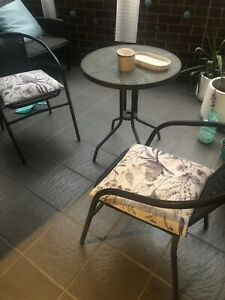 Outdoor table chairs and pillows