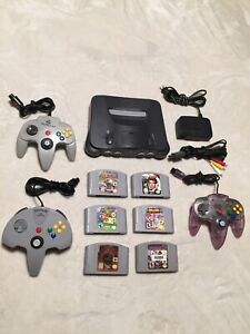 Nintendo 64 console + 6 games + 4 controllers all mint condition