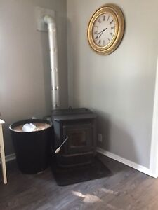 Pellet stove with piping