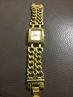 Wanted: Guess gold watch
