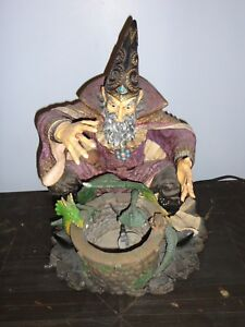 Bibelot art céramique dragon mage médiéval