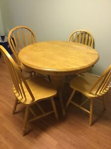 Solid wood dining table 4 chairs. 1 leaf delivery included