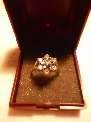 vintagegold cluster ring with sapphire blue and white stones