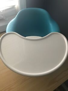 Baby blue Bumbo chair with tray