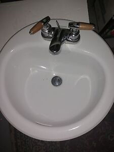 Bathroom sink and taps