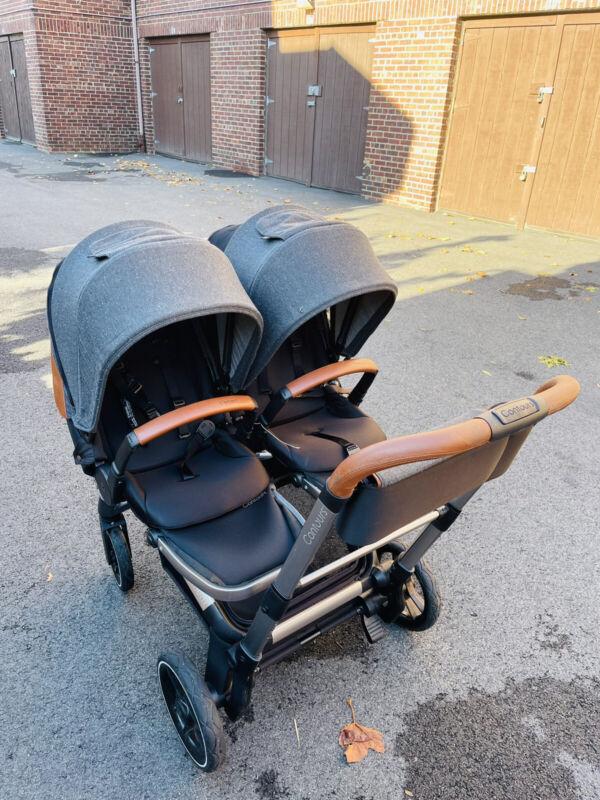Contour element double stroller