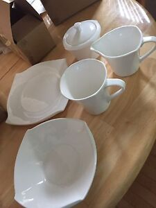 Four piece set with milk and sugar and tea pot