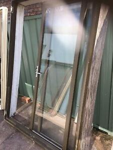 Brown aluminium bi fold doors Casula Liverpool Area Preview