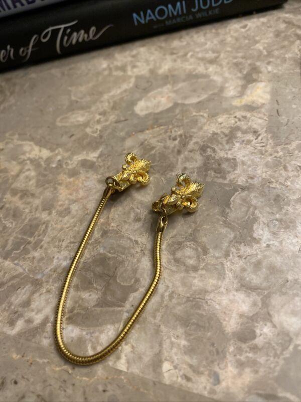 vintage GoldTone fleur-de-lis's sweater clip