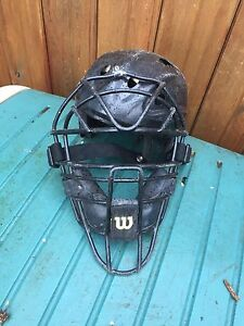 Catchers helmet with face cage