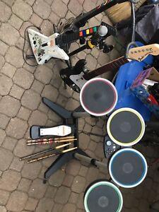 Rock band and guitar hero drums Mic and guitars