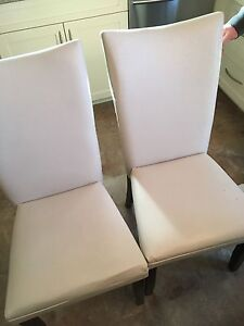 4 white chairs  50 bucks there yours