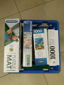 Crate of jigsaw puzzles - excellent time wasters