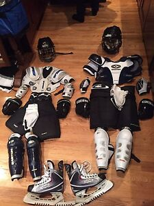 Two full sets of youth hockey equipment (size small-medium)
