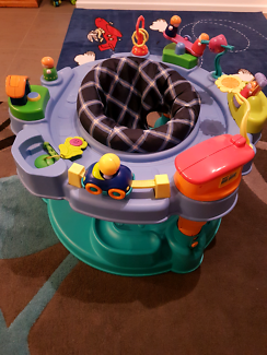 ExerSaucer by EvenFlo baby bouncer/ activity centre